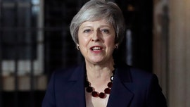 May says UK Cabinet backs Brexit deal amid wide opposition