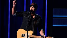 Luke Bryan shows off his dance moves during the CMA Awards