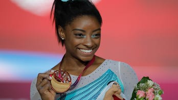 Simone Biles says she slept 'all the time' to cope with being sexually abused by Larry Nassar