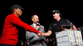 Mickelson wins match against Woods with birdie on 22nd hole