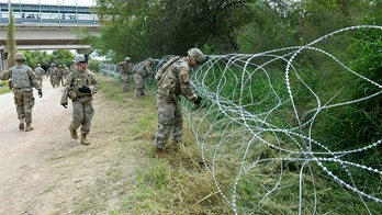 US troops seen setting up barbed wire near Mexico border