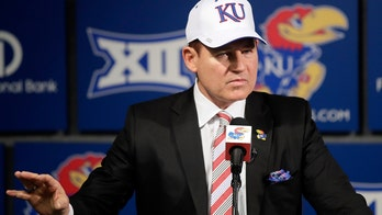 Kansas football coach Les Miles has eaten grass on the sideline before, daughter 'Smacker' says
