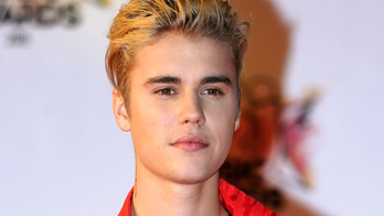Justin Bieber agrees to settle long-running suit with ex-neighbor whose house he egged