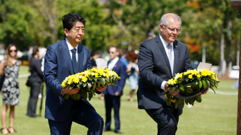 Japan's Abe lays wreath in Australia city bombed in WWII