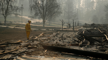 The Latest: Fire crews in California brace for high winds