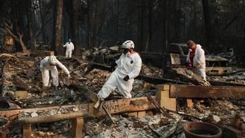 Rain helps nearly extinguish deadly California wildfire