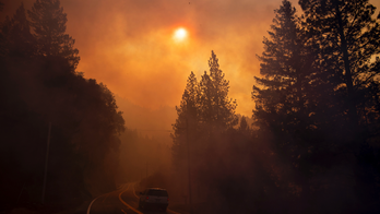 Death toll rises in California wildfire, matching deadliest