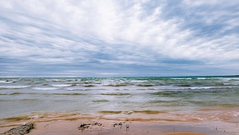 Man dead, woman missing after swimming in Lake Michigan with cold weather swim group, officials say