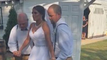 Paralyzed bride walks down aisle 3 years after horrific accident