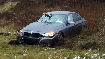 Car impaled by wood post in crash, missing driver by inches