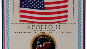 Rare Apollo 11 US flag flown to the Moon sells at auction
