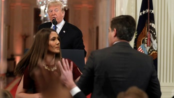 CNN's Jim Acosta struggles with White House aide to keep microphone during testy Trump exchange