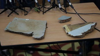 Debris off Madagascar 'most likely' from Malaysia Airlines Flight 370, report says