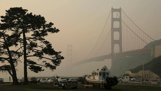 Smoke from Camp Fire smothering California cities, shuttering popular attractions in San Francisco
