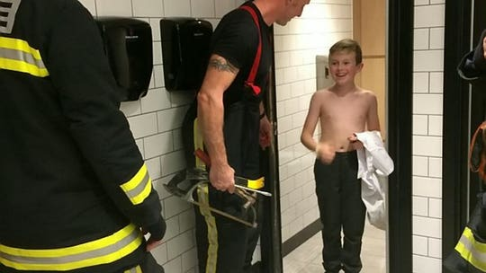 Firefighters rescue boy stuck in KFC bathroom after faulty lock traps him in stall