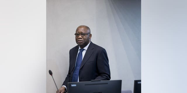 In this Thursday, Jan. 28, 2016 image, former Ivory Coast president Laurent Gbagbo arrives for the start of his trial at the International Criminal Court in The Hague, Netherlands.