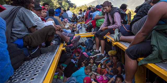 U.S.-bound Central American migrants riding on a truck that left Cordoba, Mexico.
