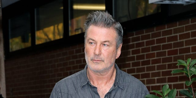 Alec Baldwin leaving NYPD's 6th precinct on Friday.