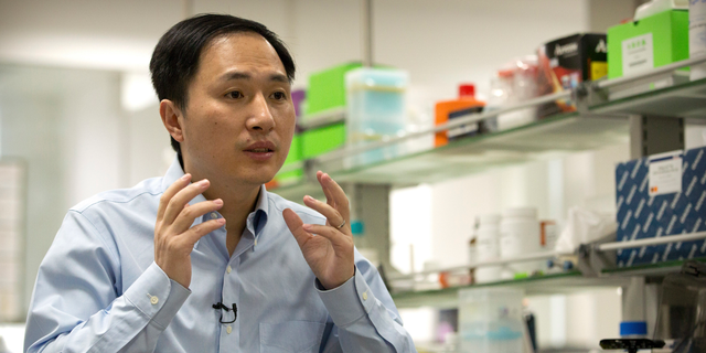 In this Oct. 10, 2018 photo, He Jiankui speaks during an interview at a laboratory in Shenzhen in southern China's Guangdong province. He claims he helped make the world's first genetically edited babies: twin girls whose DNA he said he altered.