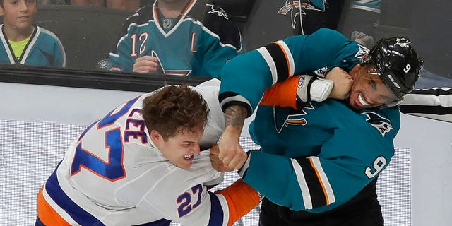 FILE: San Jose left wing Evander Kane, right, fights with New York Islanders left wing Anders Lee.