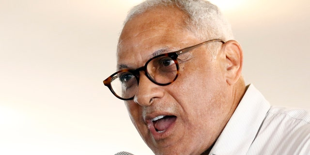 Mike Espy, a former congressman and former U.S. agriculture secretary, speaks at the Neshoba County Fair, one of the state's largest political events, in Philadelphia, Miss. Espy is challenging Sen. Cindy Hyde-Smith in a run off election for a seat in the U.S. Senate. (AP Photo/Rogelio V. Solis, File)