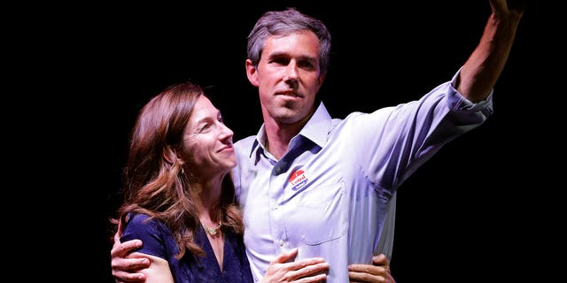 Rep. Beto O'Rourke, D-Texas, the 2018 Democratic candidate for U.S. Senate in Texas, right, stands with his wife, Amy O'Rourke, at his election night party, Tuesday, Nov. 6, 2018, in El Paso, Texas. (AP Photo/Eric Gay)