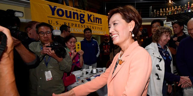 Young Kim, Republican candidate for the 39th Congressional District in California, greets supporters .