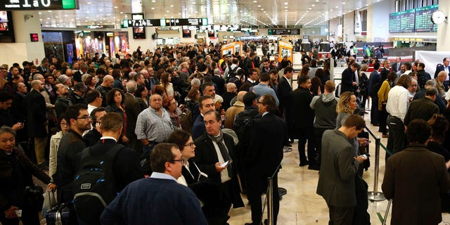 Authorities in Barcelona say the city's main train station has re-opened after it closed for more than one hour at Wednesday's rush hour while police searched for possible explosives in a suspicious suitcase. (AP Photo/Joan Monfort)
