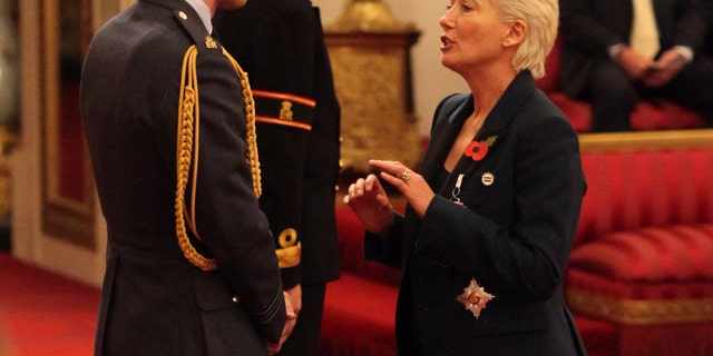 Emma Thompson is made a Dame Commander of the British Empire by Prince William at Buckingham Palace, London, Wednesday Nov. 7, 2018.