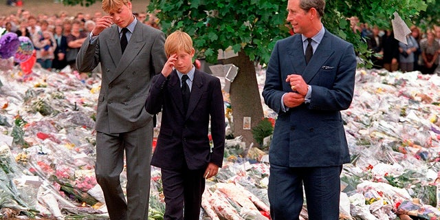 In this Friday, Sept. 5, 1997 file photo, Britain's Prince Charles accompanies his sons Prince William and Prince Harry after they arrived at Kensington Palace to view tributes left in memory of their mother Princess Diana in London. (AP Photo/David Brauchli, File)