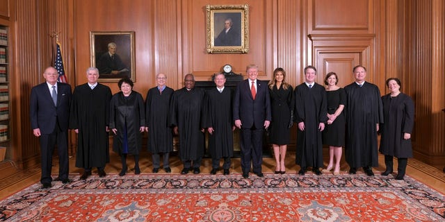 President Trump poses for a photo with Associate Justice Brett Kavanaugh in the Justices' Conference Room before an investiture ceremony Thursday, Nov. 8, 2018, at the Supreme Court in Washington.