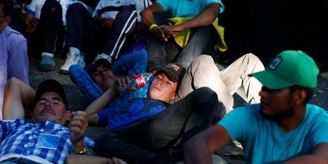 Members of the caravan which has stopped in Mexico City demanded buses Thursday to take them to the U.S. border, saying it is too cold and dangerous to continue walking and hitchhiking.