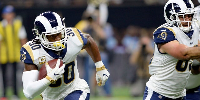 Los Angeles Rams running back Todd Gurley (30) carries for a touchdown in the first half of an NFL football game against the New Orleans Saints in New Orleans, Sunday, Nov. 4, 2018.