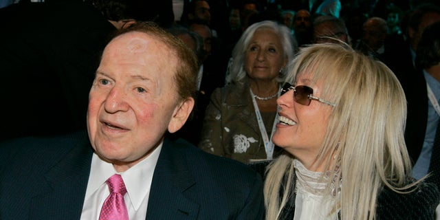 In this file photo, Sheldon Adelson, CEO of the Las Vegas Sands Corp., left, sits with his wife Dr. Miriam Adelson before a session at the President's Conference in Jerusalem.