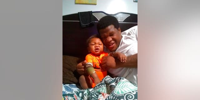 This photo provided by Avontea Boose shows her baby Tristan Roberson and the boy's father Jemel Roberson.