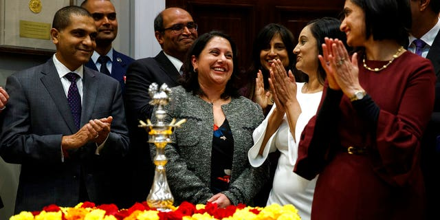 Neomi Rao smiling as President Trump announced his intention to nominate her to fill Brett Kavanaugh's seat on the U.S. Court of Appeals for the D.C. Circuit last November. (AP Photo/Evan Vucci, File)