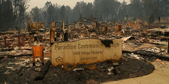 A sign stands at a community destroyed by the Camp Fire, Tuesday, Nov. 13, 2018, in Paradise, California.
