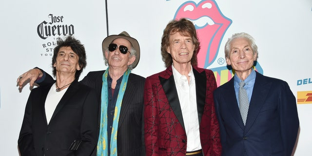 "ARCHIVE: in this archive photo of November 15, 2016, The Rolling Stones, from left to right, Ronnie Wood, Keith Richards, Mick Jagger and Charlie Watts attend the opening party of ""Exhibitionism"" in New York. The Rolling Stones will be rolling across the United States next year. The band says they are adding a 13-show stage to their No Filter tour in the spring of 2019, which will begin in Miami on April 20."