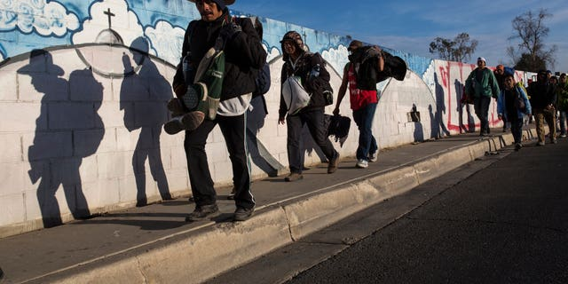 Migrants, who are part of a Central American migrant caravan, leave Mexicali for Tijuana, Mexico, Tuesday, Nov. 20, 2018. Tensions have built as nearly 3,000 migrants from the caravan poured into Tijuana in recent days after more than a month on the road.
