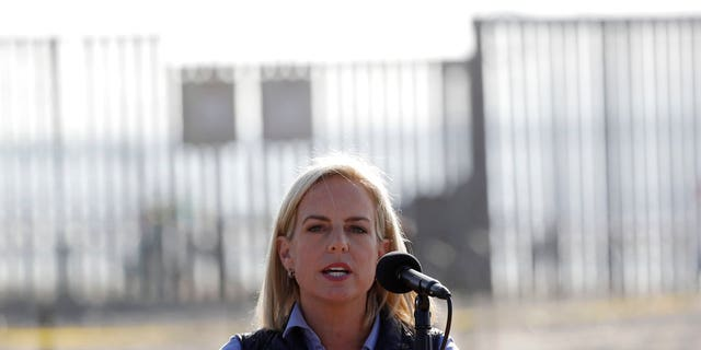 Secretary of Homeland Security Kirstjen Nielsen speaks in front of the border wall separating Tijuana, Mexico, and San Diego.