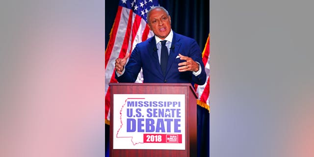 Democrat Mike Espy answers a question during a televised Mississippi U.S. Senate debate with his opponent appointed U.S. Sen. Cindy Hyde-Smith, R-Miss., in Jackson, Miss., Tuesday, Nov. 20, 2018.