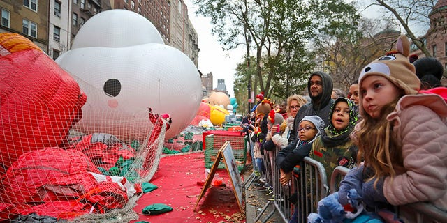 Crowds gather to see giant character balloons being inflated the night before their appearance in the 92nd Macy's Thanksgiving Day parade, Wednesday Nov. 21, 2018, in New York.