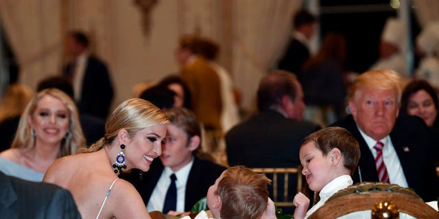 Ivanka Trump talks with her kids as she has Thanksgiving Day dinner at their Mar-a-Lago estate in Palm Beach, Fla., Thursday, Nov. 22, 2018, with President Donald Trump, left, and sister Tiffany Trump, background left.