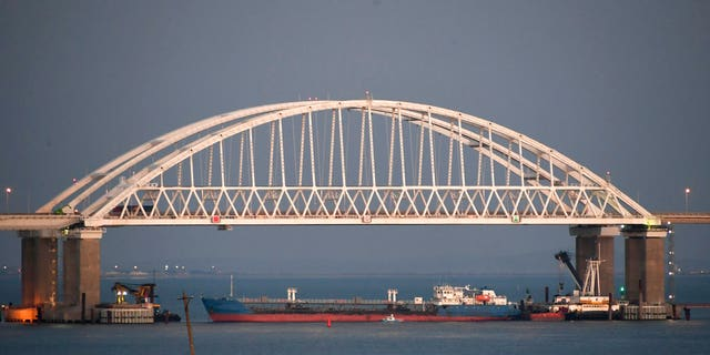 A ship under the Kerch bridge blocks the passage to the Kerch Strait near Kerch, Crimea.