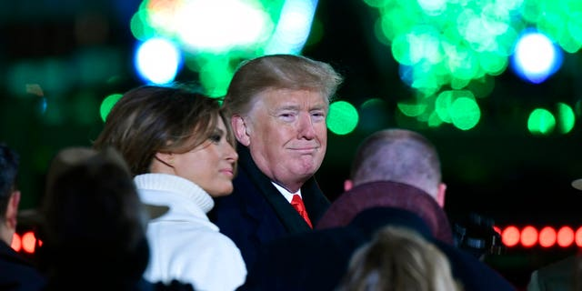 President Donald Trump and first lady Melania Trump attend the annual National Christmas Tree Lighting ceremony on the Ellipse in Washington, Wednesday, Nov. 28, 2018. (AP Photo/Susan Walsh)