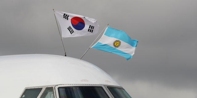 The flags of Argentina, right, and South Korea flutter atop the plane carrying South Korea's President Moon Jae-in on his arrival to the Ministro Pistarini international airport for the G20 Summit in Buenos Aires, Argentina.