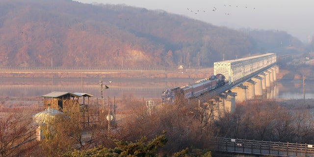 A South Korean train runs on the rail track, which the two Koreas hope to eventually use as an international transport link, near to the border village of Panmunjom in North Korea, in Paju, South Korea, Friday, Nov. 30, 2018. (AP Photo/Ahn Young-joon)