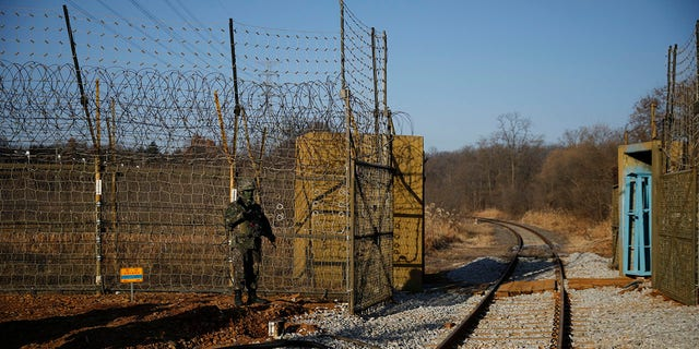 A South Korean soldier stands guard next to the rails which lead to North Korea, inside the demilitarized zone separating the two Koreas in Paju, South Korea Friday, Nov. 30, 2018. (Kim Hong-Ji/Pool Photo via AP)