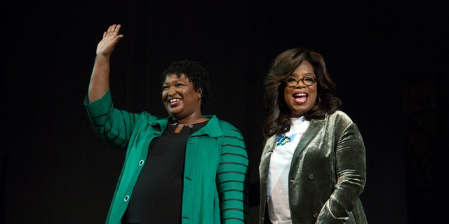 Oprah Winfrey takes part in a town hall meeting with Democratic gubernatorial candidate Stacey Abrams ahead of the mid-term election in Marietta, Georgia, U.S. November 1, 2018.