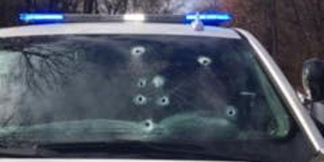 Bullet holes can be seen in Corporal Brett Thompson's vehicle after the shooting